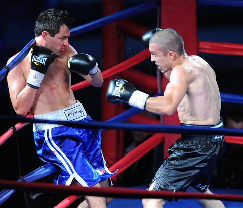 PITTSBURGH, PENNSYLVANIA - JULY 11, 2014: Jake Giuriceo looks for a opening to throw a punch at Travis Hartman during a welterweight bout Friday night at Rivers Casino. Giuriceo would win via 4th round TKO. (Photo by David Dermer/Youngstown Vindicator)
