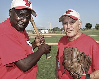 William D. Lewis The Vindicator .Senior Baseball players Charlie Harris, left, of Youngstown and Ron DiVincenzo of Boardman, both 74, play for Youngstown Classic in an over 58 baseball league.The are shown at Field of Dreams in Boardman.