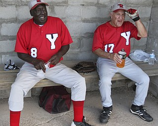 William D. Lewis The Vindicator .Senior Baseball players Charlie Harris, 74, of Youngstown and Ron DiVincenzo, 74,of Boardman play for Youngstown Classic in an over 58 baseball league at Field of Dreams in Boardman.