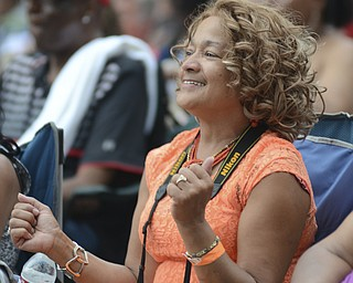 Katie Rickman | The Vindicator.Tina Glenn of Youngstown danced along during Kim Waters performance at the Jazz Festival downtown July 12, 2014.