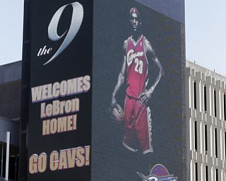 A large electronic billboard in Cleveland welcomes back NBA basketball star LeBron James Friday, July 11, 2014, after he announced he would return to the Cleveland Cavaliers after four years with the Miami Heat. (AP Photo/Mark Duncan)