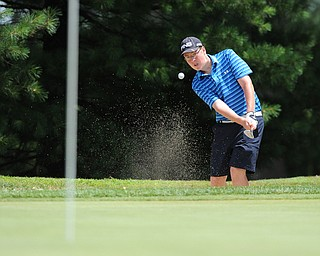 WARREN, OHIO - JULY 16, 2014: Zach Jacobson of Poland of Poland shoots out of the sand trap and onto the green on the 3rd hole Wednesday afternoon at Trumbull Country Club during the Vindy Greatest Golfer tournament. (Photo by David Dermer/Youngstown Vindicator)