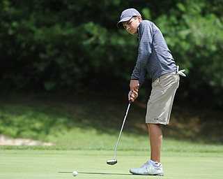 WARREN, OHIO - JULY 16, 2014: Chris Austalosh of Campbell follows through on his putt on the 3rd hole Wednesday afternoon at Trumbull Country Club during the Vindy Greatest Golfer tournament. (Photo by David Dermer/Youngstown Vindicator)