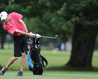 WARREN, OHIO - JULY 16, 2014: Bradley Miller of Hanoverton follows through on his approach shot on the 6th hole Wednesday afternoon at Trumbull Country Club during the Vindy Greatest Golfer tournament. (Photo by David Dermer/Youngstown Vindicator)