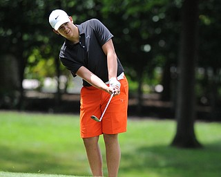 WARREN, OHIO - JULY 16, 2014: Avery Andric of Lisbon chips his ball from the short rough and onto the green on the 6th hole Wednesday afternoon at Trumbull Country Club during the Vindy Greatest Golfer tournament. (Photo by David Dermer/Youngstown Vindicator)