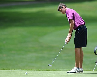 WARREN, OHIO - JULY 16, 2014: Jacob Wilson of Sharon follows through on his putt on the 6th hole Wednesday afternoon at Trumbull Country Club during the Vindy Greatest Golfer tournament. (Photo by David Dermer/Youngstown Vindicator)
