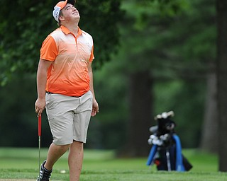 WARREN, OHIO - JULY 16, 2014: Cameron Gumble of Austintown reacts after his ball stopped just shot of the hole on the 5th hole Wednesday afternoon at Trumbull Country Club during the Vindy Greatest Golfer tournament. (Photo by David Dermer/Youngstown Vindicator)