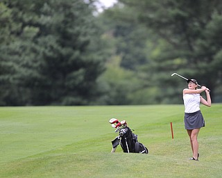 WARREN, OHIO - JULY 16, 2014: Emily Koehler of Vienna watches as her ball flies toward the green on the 2nd hole Wednesday afternoon at Trumbull Country Club during the Vindy Greatest Golfer tournament. (Photo by David Dermer/Youngstown Vindicator)