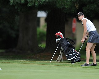 WARREN, OHIO - JULY 16, 2014: Emily Koehler of Vienna  follows through on her putt on the 2nd hole Wednesday afternoon at Trumbull Country Club during the Vindy Greatest Golfer tournament. (Photo by David Dermer/Youngstown Vindicator)
