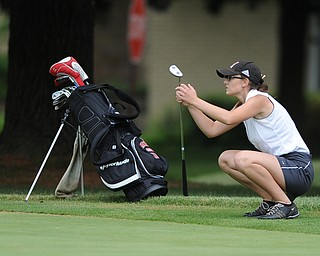 WARREN, OHIO - JULY 16, 2014: Emily Koehler of Vienna reacts after her putt falls shot of the hole on the 2nd hole Wednesday afternoon at Trumbull Country Club during the Vindy Greatest Golfer tournament. (Photo by David Dermer/Youngstown Vindicator)