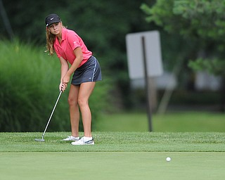 WARREN, OHIO - JULY 16, 2014: Taylor Vassis of Vienna follows through on her putt on the 2nd hole Wednesday afternoon at Trumbull Country Club during the Vindy Greatest Golfer tournament. (Photo by David Dermer/Youngstown Vindicator)