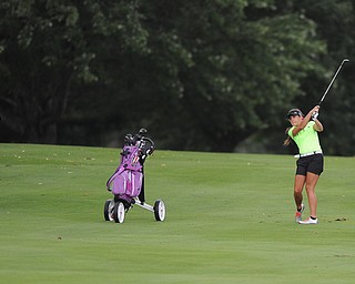 WARREN, OHIO - JULY 16, 2014: Nicole Gula of Howland follows through on her approach shot on the 2nd hole Wednesday afternoon at Trumbull Country Club during the Vindy Greatest Golfer tournament. (Photo by David Dermer/Youngstown Vindicator)