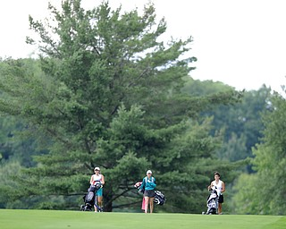 WARREN, OHIO - JULY 16, 2014: Emily Coller, Sarah Brindley and Sarah Brindley walk on the fairway on the 2nd hole Wednesday afternoon at Trumbull Country Club during the Vindy Greatest Golfer tournament. (Photo by David Dermer/Youngstown Vindicator)