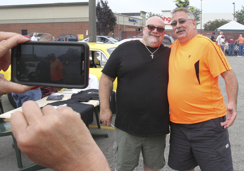 william D. Lewis The Vindicator  Fat and Furious cast member Tommy Christmas, left, poses for a snapshot with Mike Rohan of Youngstown during a car show at Quaker Steak and Lube in Boardman.