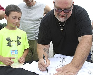 william D. Lewis The Vindicator  Fat and Furious cast member TommyChristmas signs an autograph for Todd Miller, 9, of Poland during a car show at Quaker Steak and Lube in Boardman.