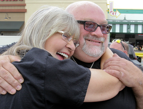 william D. Lewis The Vindicator  Fat and Furious cast member Tommy Christmas gets a hug from fanPatty Shobel of Austintown during a car show at Quaker Steak and Lube in Boardman.