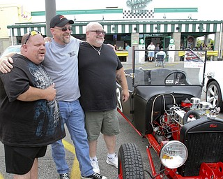 William D. Lewis The Vindicator  Fat and Furious cast members Chuck Kountz, left, and Tommy Christmas pose with fan Mike Powell of East Palestine, center, during a car show at Quaker Steak and Lube in Boardman.