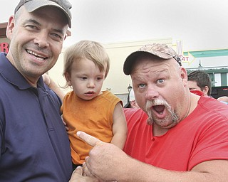 william D. Lewis The Vindicator  Fat and Furious cast member Steve McGranahan, right, poses for a photo with Adam Earnheardt of Liberty and his son Oscar, 20 months during a car show at Quaker Steak and Lube in Boardman 7-18-14.