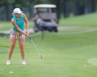 WARREN, OHIO - JULY 27, 2014: Nicolette Eddy follows through on her putt on the 9th hole Sunday afternoon at Avalon Lakes Country Club during the Vindy Greatest Golfer Tournament. (Photo by David Dermer/Youngstown Vindicator)