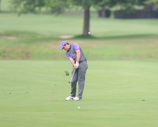WARREN, OHIO - JULY 27, 2014: Donavan Ray follows through on his approach shot on the 16th hole Sunday afternoon at Avalon Lakes Country Club during the Vindy Greatest Golfer Tournament. (Photo by David Dermer/Youngstown Vindicator)