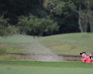 WARREN, OHIO - JULY 27, 2014: Bradley Miller follows through on a shot out of the bunker on the 14th hole Sunday afternoon at Avalon Lakes Country Club during the Vindy Greatest Golfer Tournament. (Photo by David Dermer/Youngstown Vindicator)