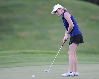 WARREN, OHIO - JULY 27, 2014: Cait Butler follows through on her putt on the 18th hole Sunday afternoon at Avalon Lakes Country Club during the Vindy Greatest Golfer Tournament. (Photo by David Dermer/Youngstown Vindicator)