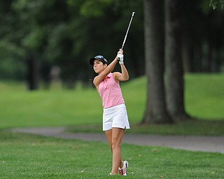 WARREN, OHIO - JULY 27, 2014: Christina Cooper follows through on her approach shot from the rough on the 18th hole Sunday afternoon at Avalon Lakes Country Club during the Vindy Greatest Golfer Tournament. (Photo by David Dermer/Youngstown Vindicator)