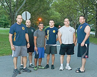 Eight of the Campbell Police Department's 13 full-time officers elected to take — and passed — a physical-fitness exam Sunday, and each will receive a $1,000 stipend for their efforts. Drew Rauzan, the department's chief who is pictured at the far right, passed the test as well, but was not eligible for the stipend. Also pictured are, from left, Rob Vukovich, Joe Pavlansky, John Gulu, Bobby Curtis and Mitch Zupko.