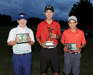 U-14 Boys Cole Christman, Jared Wilson and Jimmy Graham pose for a picture with their trophies Sunday evening at Avalon Lakes Country Club, wrapping up the 2014 Greatest Golfer of the Valley Junior Tournament.