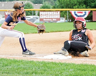 Canfield baserunner Lauren Fitzgerald is safe at third base during Tuesday's 4-0 win over Tallmadge. Defending is Tallmadge's Gia Casalinova.