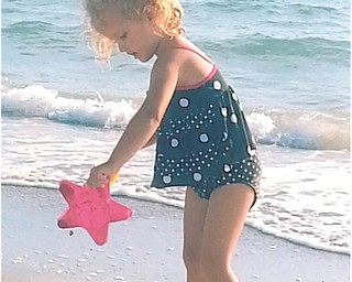 Mena Monroe is having fun at Indian Rocks Beach in Florida. Sent by grandparents Russ and Ellen Monroe.