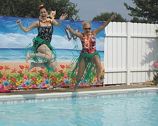 Granddaughters of the late Irwin and Elizabeth Ferry gathered at the home of Linda (Burns) Estes in Poland for a day of relaxing in the sun. Cousins, Charon (Jenkins) Cuprik and Barbara (Ferry) Kelly, both of Boardman, jumped into the pool. Submitted by Laurie (Burns) Fox.