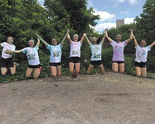 June 14 in downtown Youngstown at the Color Run, this is a group of Jackson Milton middle school girls are resting after finishing the run. From left are Ayla, Sierra, Taylor, Ashley, Emily, Marisa, and Rose. Submitted by Cheryl Jonesco of Lake Milton.