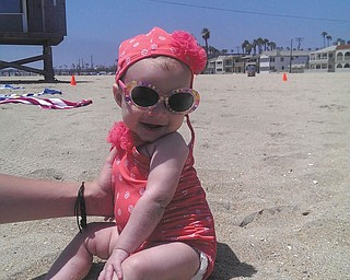 California Beach Baby is sitting pretty (with help from her mommy, Brittany Jenkins). Four-month-old Kyra smiles at her grandma, Wendy Jenkins, who took this photo at Seal Beach, Calif. All are Boardman residents. Great-gma Peg Sigle of Boardman submitted the photo.