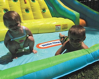 Jimmy Putko, 4, and Julia Putko, 1 and 1/2, both of Boardman were splashing and sliding around in the sun!