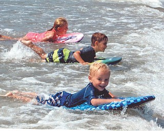 "At the beach in Avalon, N.J., are Ava, Chase and Talin Massullo, ""Surfin' USA"". Submitted by grandparents Al and Sandy Massullo of Austintown."