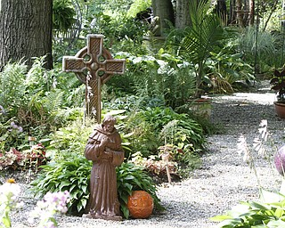 ROBERT K. YOSAY  | THE VINDICATOR.. a pathway at the Our Lady of the Lakes Parish-- has an oasis for solitude or just reflection or just enjoying the flowers as the Rev. David W. Merweiler is pastor and gardener.....  -30-