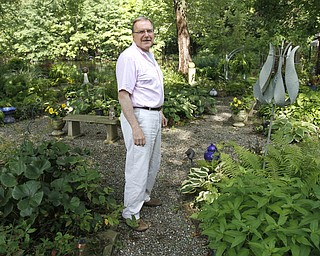 ROBERT K. YOSAY  | THE VINDICATOR.. Our Lady of the Lakes Parish-- has an oasis for solitude or just reflection or just enjoying the flowers as the Rev. David W. Merweiler is pastor and gardener.....  -30-