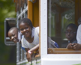 Katie Rickman | The Vindicator.Mykhi (OKAY) Moore, 8, Aija (OKAY) Clarett, 11,L-R and Kimora Jones, 8, all of Youngstown....The friends all from Youngstown ride the Cohasset Trolley from the Family Camp and around the park August 9, 2014.