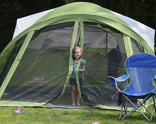 Katie Rickman | The Vindicator.Finley Blackann, 3, of Boardman peeks out of the tent as her father Josh works behind her at Wick Recreation Area at Mill Creek MetroPark August 9, 2014.