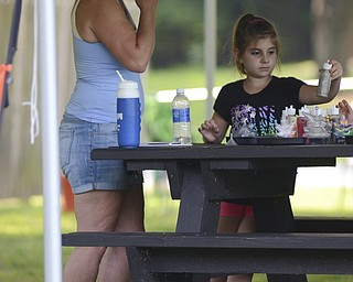 Katie Rickman | The Vindicator.Kim Carolyne of North Lima stands next to her granddaughter Corena Carolyne, 7, as she works on a craft at the Family Camp at Mill Creek MetroPark August 9, 2014.
