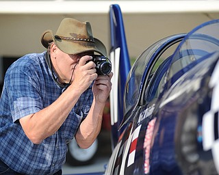 Jeff Lange | The Vindicator  Airplane enthusiast Kevin Yurcheckfrodel takes a quick picture of the cockpit of a replica F4U Corsair, Saturday afternoon at the opening of the Ernie Hall Aviation Museum in Warren.