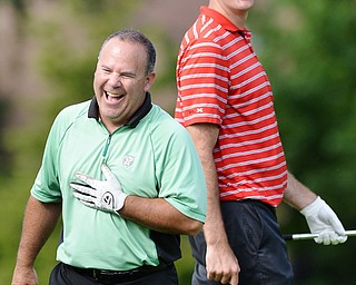 Jeff Lange | The Vindicator  Rick Leonard of Niles (left) and teammate share a moment of laughter together during play Monday afternoon at the Lake Club.