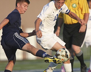 William D. Lewis the Vindicator  Poland's AnthonySabula(10) and Fitch's Drake Sahli(8) go for the ball during Tuesday 8-19-14 action at Poland.