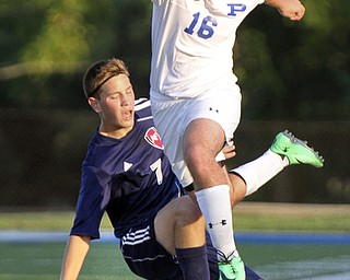 William D. Lewis the Vindicator  Poland's Kevin Cicuto(16) and Fitch'sAlex Kilpatrick(7) go for the ball during Tuesday 8-19-14 action at Poland.