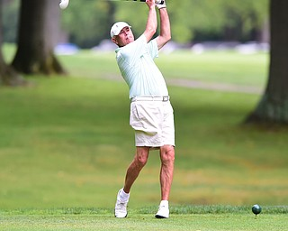 BOARDMAN, OHIO - AUGUST 22, 2014: Jon Mrus of Warren tees off on the 10th hole on the south course Friday morning at Mill Creek Golf Course during the Vindy Greatest Golfer Tournament. (Photo by David Dermer/Youngstown Vindicator)