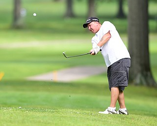 BOARDMAN, OHIO - AUGUST 22, 2014: Dave Campman of Austintown follows through on a approach shot on a hole on the north course Friday morning at Mill Creek Golf Course during the Vindy Greatest Golfer Tournament. (Photo by David Dermer/Youngstown Vindicator)