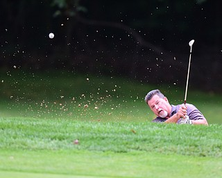 BOARDMAN, OHIO - AUGUST 22, 2014: John Thompson of Palm Creek, Florida shoots his ball out of the sand trap and onto the green on the 18th hole on the south course Friday morning at Mill Creek Golf Course during the Vindy Greatest Golfer Tournament. (Photo by David Dermer/Youngstown Vindicator)