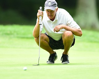 BOARDMAN, OHIO - AUGUST 22, 2014: Tom Korner of Salem lines up his putt on the 18th hole on the south course Friday morning at Mill Creek Golf Course during the Vindy Greatest Golfer Tournament. (Photo by David Dermer/Youngstown Vindicator)