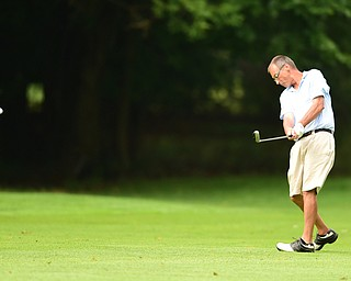 BOARDMAN, OHIO - AUGUST 22, 2014: Lenny Bruno of Youngstown follows through on his approach shot on the 9th hole on the south course Friday morning at Mill Creek Golf Course during the Vindy Greatest Golfer Tournament. (Photo by David Dermer/Youngstown Vindicator)